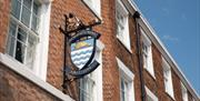An image of the Beverley Arms sign hanging from the exterior.