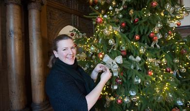 An image of a Christmas tree being decorated in Burton Agnes Hall