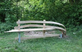 An image of a bench inscribed with a poem - part of WANDER art in the landscape