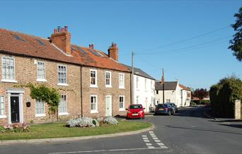 An image of a row of cottages at Holme on Spalding Moor